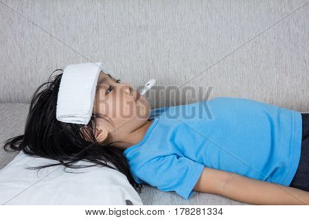 Asian Chinese Little Girl Getting Measurement For Fever Temperature
