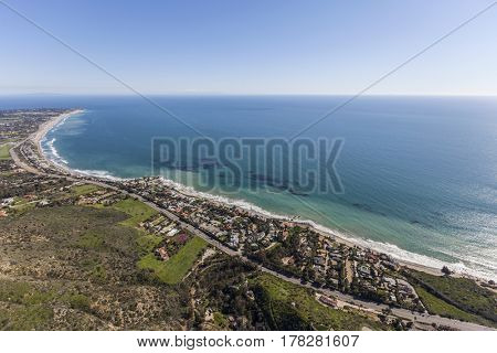 Aerial view of Pacific Ocean view homes north of Los Angeles in Malibu, California.