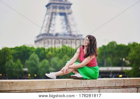 Young Girl Near The Eiffel Tower In Paris
