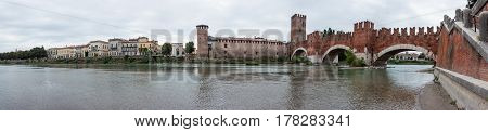 Ponte Scaligero bridge Castelvecchio castle and the area adjacent to them. View from the left bank of Adige river in Verona Italy