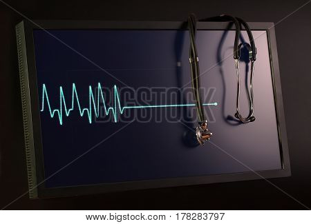 Fading cardiogram and stethoscope on the monitor