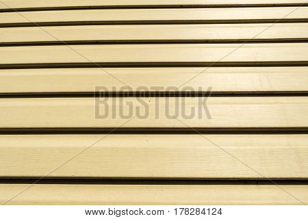 Siding. House siding background. detail of a house wall. Beige siding.