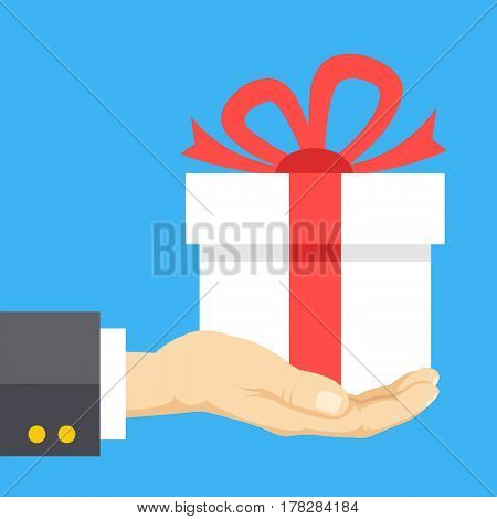 Hand holding gift box. Giftbox with red ribbon and beautiful red bow. Gift, present concepts. Modern flat design graphic elements. Creative vector illustration isolated on blue background
