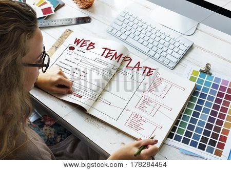 Woman working on notebook network graphic overlay