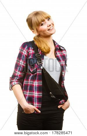 Gardening concept. Smiling attractive woman in pink check shirt and dungarees hands in pocket. Isolated background