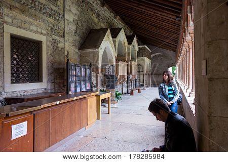 Few Visitors Inspecting Basilica Di San Zeno Maggiore  In Verona