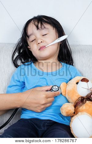 Asian Chinese Little Girl Examine By Doctor With Stethoscope