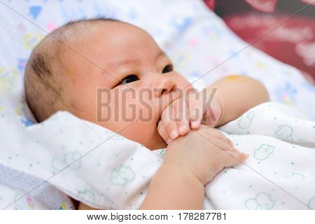 Asian Baby Keep Hand In The Mouth