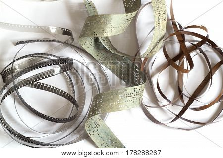 Fragments of old film magnetic tape and punched tape