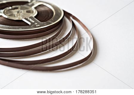 Old reel with magnetic tape for the record player
