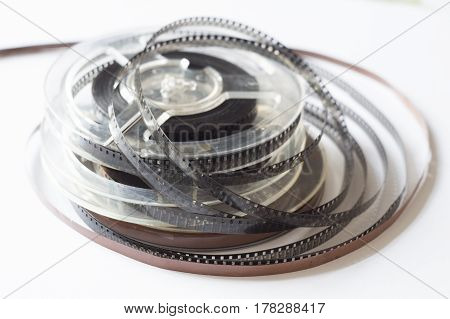 Old reels with black and white film and a magnetic tape