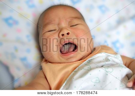 New Born Asian Baby Crying On Bed