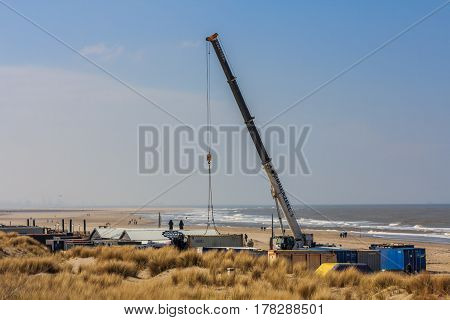 The Hague the Netherlands - March 24 2017: crane building beach cafe ready for the summer