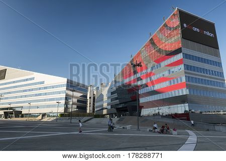 MILAN, ITALY - AUGUST 27, 2016: Milan (Lombardy Italy): modern office building in the new Portello area hosting the headquarter of A.C. Milan historic football club amd people in the square