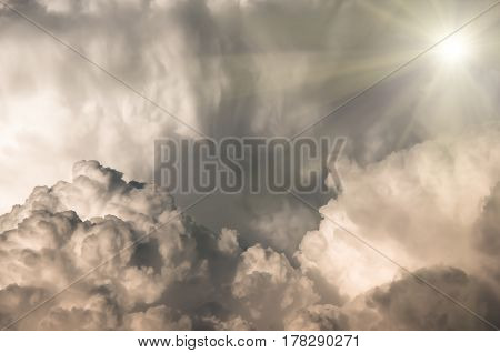 large cumulus clouds and sun before a storm natural background