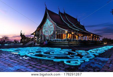 Ubon Ratchathani Thailand - December Wat Sirindhornwararam (Phu Prao Temple) Fluorescent tree and stone in twilight shot on the December 30 2016 in Ubon Ratchathani Thailand