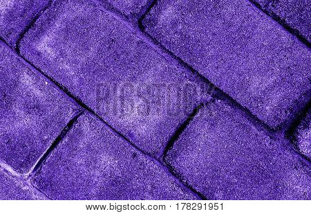 Abstract image of a brick wall the color of lilac. Grunge brick wall. Brick, brick texture, brick background. Lilac background.