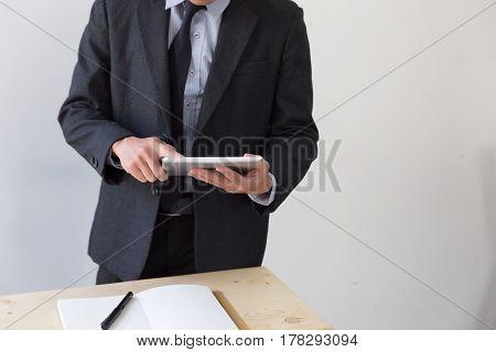 Businessman Watching Something On Digital Tablet In Office