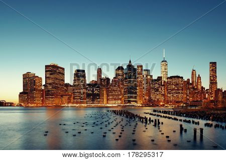 New York City downtown skyline with pier remains at dusk