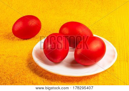 Red dyed Easter eggs on a saucer