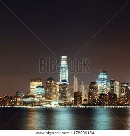 New York City skyline at night with downtown skyscrapers