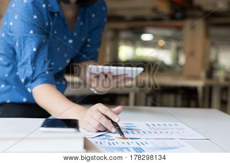 Business Woman Analyzing Income Charts And Graphs With Digital Tablet. Business Analysis And Strateg