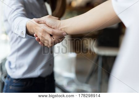 Business Handshake. Two Startup Business Woman Shaking Hands With Each Other In The Office.