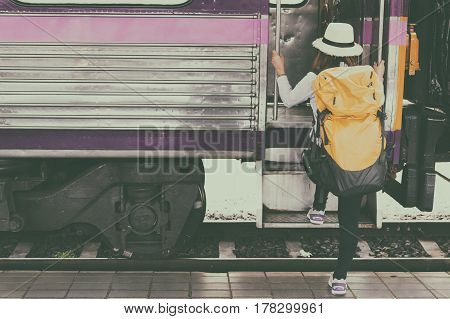 Traveler Girl With Backpack Walk Up The Train Alone. Travel Journey By Train