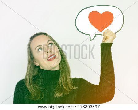 Woman holding love heart speech bubble