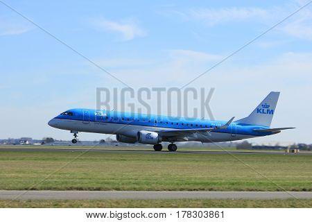 Amsterdam the Netherlands - March 25th 2017: PH-EZR KLM Cityhopper Embraer ERJ-190 takeoff from Polderbaan runway.