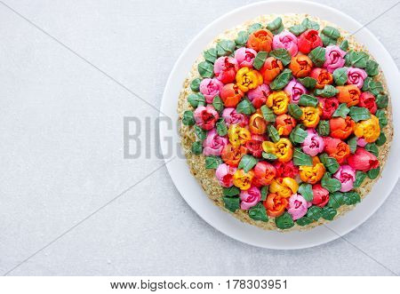 Buttercream flower tulip cake beautiful festive cake decorated with colorful cream flowers for spring holidays