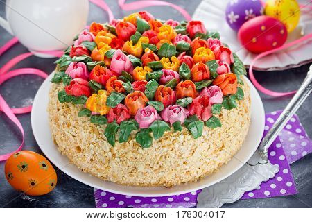 Buttercream flower tulip cake beautiful festive cake decorated with colorful cream flowers for Easter