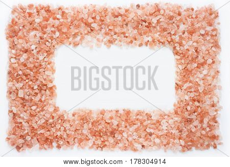 Pink himalayan salt frame isolated on white background