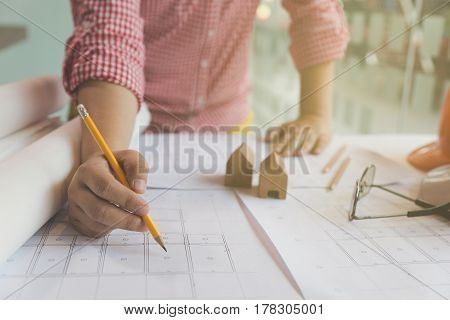 Architect Or Engineer Working With Blueprints In Office, Construction Concept.