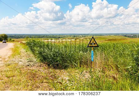 NOVGOROD REGION RUSSIA - JULY 6 2014: Pointer to the site where high pressure gas pipeline