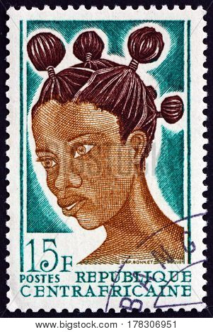 CENTRAL AFRICAN REPUBLIC - CIRCA 1967: a stamp printed in Central African Republic shows African Hair Style circa 1967