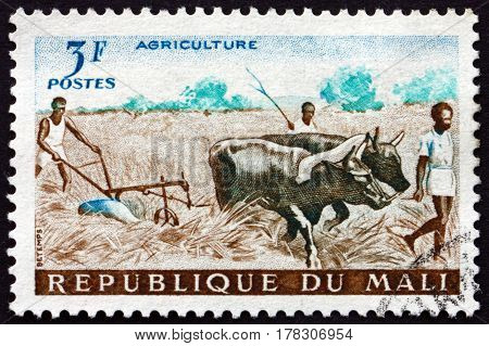 MALI - CIRCA 1961: a stamp printed in Mali shows Plowing circa 1961