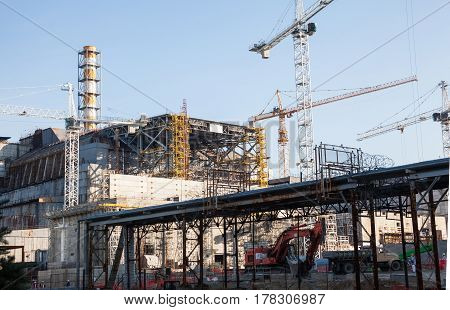 CHERNOBYL UKRAINE - OCTOBER 16 2015: Construction of New Safe Confinement (or New Shelter) at Chernobyl Nuclear Power Plant over the nuclear reactor destroyed by Chernobyl disaster in 1986.
