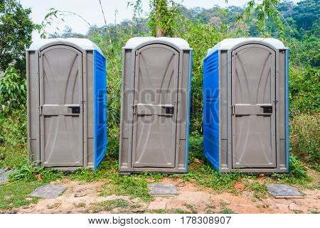 Three Rooms of Public Plastic Mobile Toilet in Forest