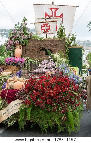 FUNCHAL MADEIRA PORTUGAL - SEPTEMBER 4 2016: Decorations with flowers during Madeira Wine Festival - Historical and Ethnographic parade in Funchal on Madeira. Portugal