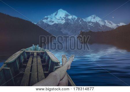 Man Resting On A Alpine Lake