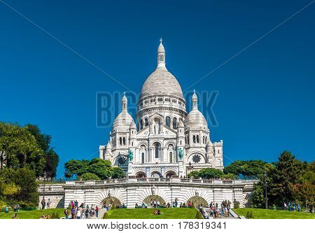 PARIS - SEPTEMBER 24, 2013: Basilica of the Sacred Heart of Jesus (Basilique du Sacre-Coeur). A popular landmark it is located at the summit of the Montmartre hill the highest point in Paris.