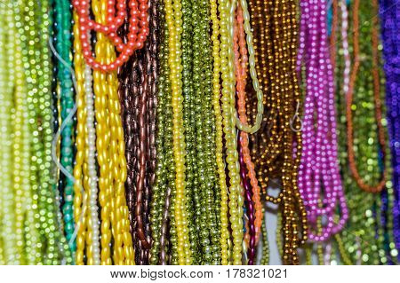 Strings Of Colorful Beads Hung At Outdoor Crafts Market