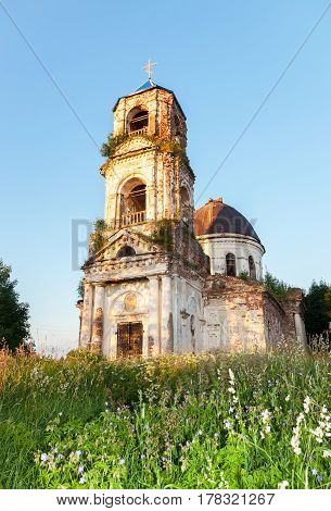 Old abandoned orthodox church in the sunset light in Novgorod region Russia