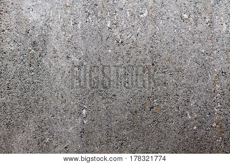 Concrete wall with small holes. background macro