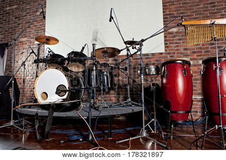 Musical background. Drum kit on stage lights performance