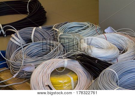 Rolls Of Cable Various Colors And Diameter On A Wooden Pallet