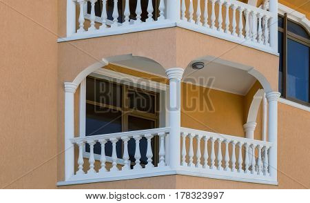 A fragment of the beautiful facade of the hotel with architectural details: Windows a balcony.