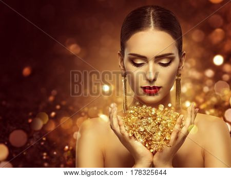 Fashion Model Holding Gold Jewelry in Hands Woman Golden Beauty Beautiful Girl Makeup and Luxury Jewellery