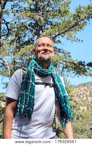 Smiling Bearded Man, Traveler Stands In The Mountains